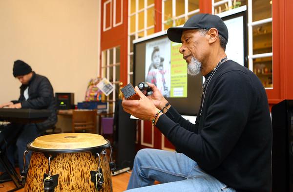 Darnell Smith plays shakers during BlacKokomo History Fest at Beyond Barcodes Bookstore on Friday, Feb. 7.<br /> Kelly Lafferty Gerber | Kokomo Tribune