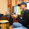 Darnell Smith plays shakers during BlacKokomo History Fest at Beyond Barcodes Bookstore on Friday, Feb. 7.<br /> Kelly Lafferty Gerber | Kokomo Tribune