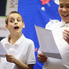 Fourth-grader Xander Snow, left, shows his expressiveness as he participates in a poetry reading along with fifth-grader Ladainian Foster, right, at Elwood Haynes Elementary on Wednesday, January 15, 2020.<br /> Kelly Lafferty Gerber | Kokomo Tribune