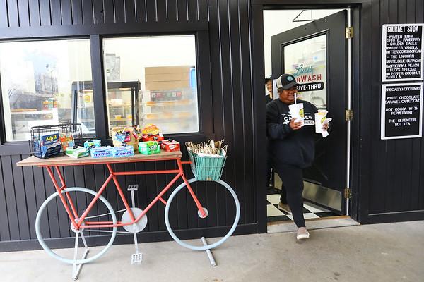 Christin Becker brings drinks to a customer at Luci's Carwash and Drive Thru in Converse on January 3, 2020.<br /> Tim Bath   Kokomo Tribune