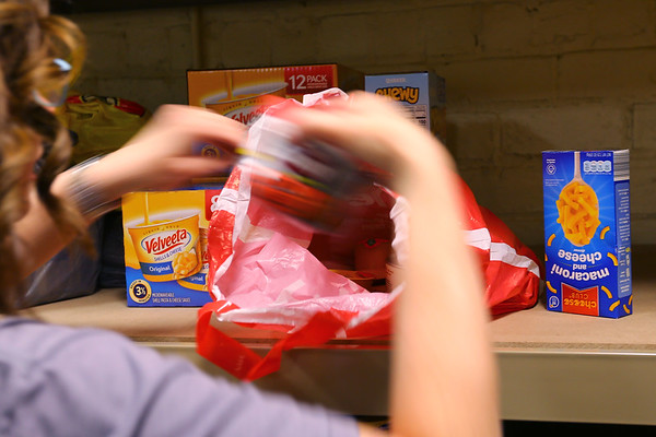 Michele DeVault and Michelle Yoder organize the donation of food for the Buddy Bag program at Howard Elementary School on January 27, 2020. Bags of food are sent home with kids that need it on Fridays.<br /> Tim Bath | Kokomo Tribune