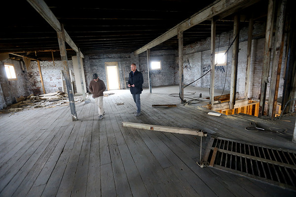DJ Butcher talks with contractor Kerry Featherston in his building at 120 W Monroe Street along the Industrial Heritage Trail on January 30, 2020.<br /> Tim Bath | Kokomo Tribune