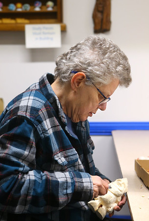 Jane Peterson carves a Santa during an open carving meeting at Converse's Eastern Woodland Carvers Club on January 14, 2020.<br /> Kelly Lafferty Gerber | Kokomo Tribune