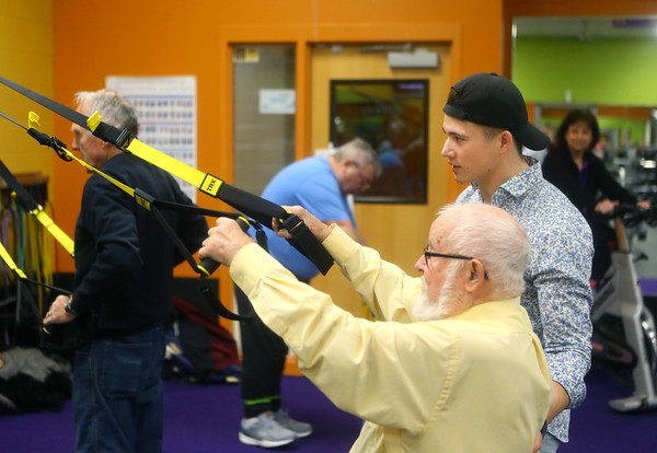 Dakota Cole works with John Hunter during the Actively Aging class on Jan. 22, 2020. Cole, manager of Tipton's Anytime Fitness was on Undercover Boss when brand president of Anytime Fitness came for a visit.<br /> Kelly Lafferty Gerber | Kokomo Tribune