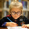 Trinity Staggs, 6, dressed as Harry Potter, colors a Harry Potter picture during the Harry Potter Yule Ball at Kokomo-Howard County Public Library on Friday, January 3, 2020.<br /> Kelly Lafferty Gerber | Kokomo Tribune