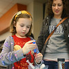 Lucy Perry, 8, makes a craft as her mom Kim Perry watches during the Harry Potter Yule Ball at Kokomo-Howard County Public Library on Friday, January 3, 2020.<br /> Kelly Lafferty Gerber | Kokomo Tribune