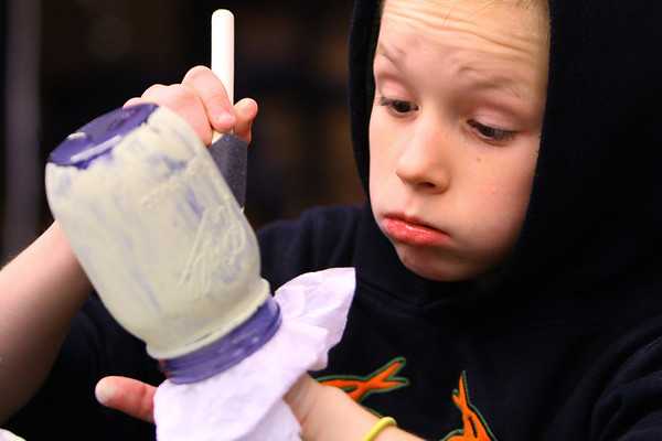 Kokomo Urban Outreach programs that teach kids life skills and helps them earn some money on January 27, 2020. Gage Scoles, 11, painting mason jars as part of the project they are working on in the Up Program.<br /> Tim Bath | Kokomo Tribune