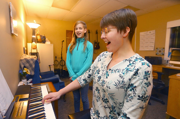 Sami Soutar, right, works on scales with student Harley Lightsey, 12, during a piano and vocal lesson at Rhum Academy on January 9, 2020.<br /> Kelly Lafferty Gerber | Kokomo Tribune