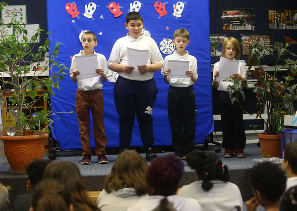 From left: fourth-grader Xander Snow, fifth-grader Ladainian Foster, fifth-grader Jeremy Ebert, and third-grader Liam Porter read poetry for an audience of their peers in Terri White's special education class at Elwood Haynes Elementary on Wednesday, January 15, 2020.<br /> Kelly Lafferty Gerber | Kokomo Tribune