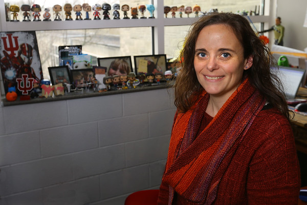 IUK Professor Erin Doss in her office wearing a sweater and scarf that she knitted on January 28, 2020. <br /> Tim Bath | Kokomo Tribune