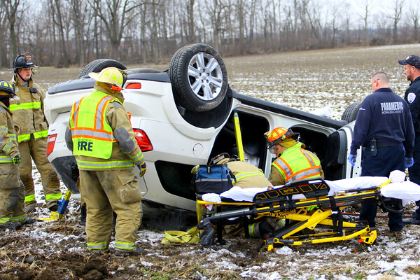 Greentown Volunteer firefighters cut a woman out of the Dodge Journey that she was trapped in after colliding with a small red car at the intersection of 400 East and Sr. 22 on January 29, 2020. <br /> Tim Bath | Kokomo Tribune