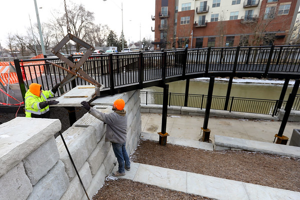 Gary Boggs and Jeremy Sampson from Bowyer Excavating work on some finishing touches along the Wildcat Creek Walk of Excellence near Union Street on January 22, 2020.<br /> Tim Bath | Kokomo Tribune