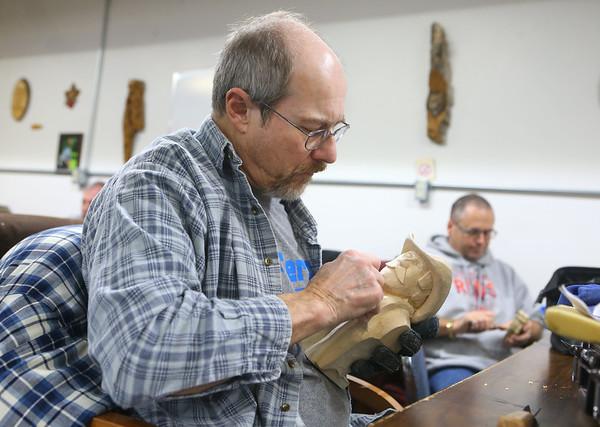 Jack Shelton works on his carving at Converse's Eastern Woodland Carvers Club on January 14, 2020.<br /> Kelly Lafferty Gerber | Kokomo Tribune