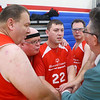 Coach Tom Tolen, far right, and the Howard County Tom Kats huddle up before the start of their 3-on-3 game against the White County Warriors during the Special Olympics of Howard County basketball tournament at Kokomo High School on Saturday, January 11, 2020.<br /> Kelly Lafferty Gerber | Kokomo Tribune