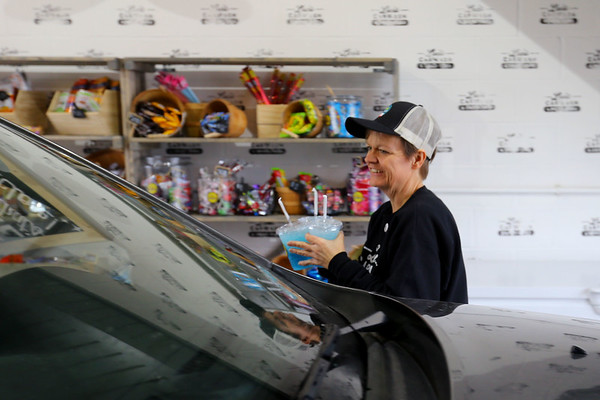 Carol Kirk gets ready to hand drinks to a customer at Luci's Carwash and Drive Thru in Converse on January 3, 2020.<br /> Tim Bath | Kokomo Tribune
