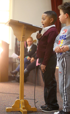 F.D. Reese Christian Academy first-grader John Edward Hill, Jr. reads an excerpt of Dr. Martin Luther King, Jr.'s Mountain Top speech as kindergartner Kingston Spruill stands by his side at Second Missionary Baptist Church on Saturday, Jan. 18, 2020.<br /> Kelly Lafferty Gerber | Kokomo Tribune