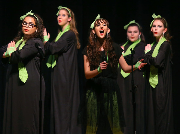 """Taylor High School junior Alayna Sinko, center, sings Madonna's """"Like a Prayer"""" as she performs with Taylor High School's Glitz & Glamour Show Choir during their pre-cruise performance featuring music from different female performers from the 1940s-2000s on Thursday, Jan. 9, 2020. The show choir will be performing as part of the entertainment line up on the Carnival Elation  cruising to the Bahamas January 16-20. <br /> Kelly Lafferty Gerber 