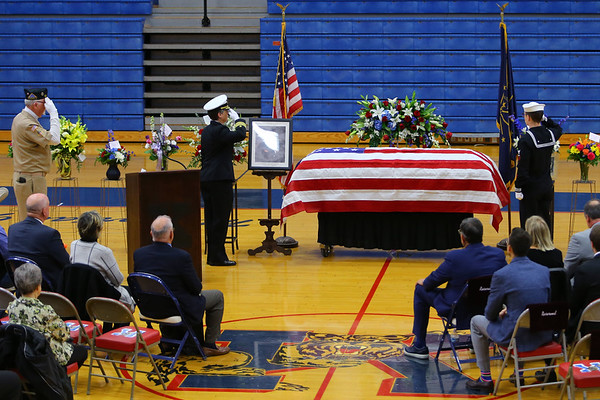 Two US Navy representatives stand at attention at coach Carl McNulty's casket while the honor guard fires the three-volley salute outside Memorial Gym on January 20, 2020.<br /> Tim Bath   Kokomo Tribune