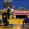 Two US Navy representatives stand at attention at coach Carl McNulty's casket while the honor guard fires the three-volley salute outside Memorial Gym on January 20, 2020.<br /> Tim Bath | Kokomo Tribune