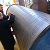 Indiana University Kokomo officials announce the launch of a $3 million fund raising campaign to help pay for the new Student Activities and Event Center on January 27, 2020. Head soccer coach Terry Stewart and student and soccer player Jelianna Habel sign a piece of heating and cooling ductwork for the new building.<br /> Tim Bath | Kokomo Tribune