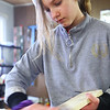 Kokomo Urban Outreach programs that teach kids life skills and helps them earn some money on January 27, 2020. Ten year-old Kylee Sharp sands the wood that is to be used to make wood boxes as part of the project they are working on and selling online.<br /> Tim Bath | Kokomo Tribune