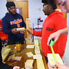 Kokomo Urban Outreach programs that teach kids life skills and helps them earn some money on January 27, 2020. Mentor Harbey Lenoir works with fifteern year-old Ralph Mitchell helping him learn woodworking skills.<br /> Tim Bath | Kokomo Tribune