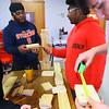 Kokomo Urban Outreach programs that teach kids life skills and helps them earn some money on January 27, 2020. Mentor Harbey Lenoir works with fifteern year-old Ralph Mitchell helping him learn woodworking skills.<br /> Tim Bath | Kokomo Tribune