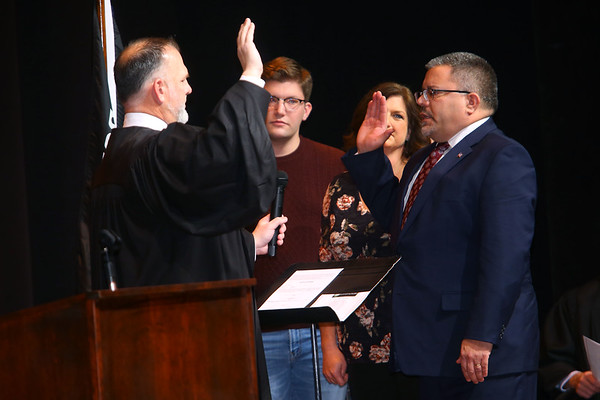 Judge Parry gives the oath of office to Kokomo City Council member Matthew Grecu in front of hundreds at Central Middle School on January 1, 2020.<br /> Tim Bath | Kokomo Tribune