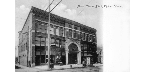 MARTZ THEATER BLOCK, TIPTON IN: SEPIA TONE, FRONT VIEW INCLUDING POST OFFICE, CLOTHING STORE, LAWYERS' OFFICE, KIOSK ADVERTISING PLAYS, CARTS.<br /> Data ProviderAllen County Public Library