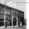 MARTZ THEATER BLOCK, TIPTON IN: SEPIA TONE, FRONT VIEW INCLUDING POST OFFICE, CLOTHING STORE, LAWYERS' OFFICE, KIOSK ADVERTISING PLAYS, CARTS.<br /> Data Provider	Allen County Public Library