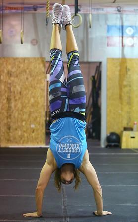 Laura Conkle does a walking handstand across the floor at CrossFit Kokomo on January 4, 2020.<br /> Kelly Lafferty Gerber   Kokomo Tribune