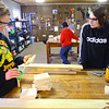 Kokomo Urban Outreach programs that teach kids life skills and helps them earn some money on January 27, 2020. Khloe Brittain, 17 and Gabby Breidinger, 13 work in the wood shop making boxes that the group will sell.<br /> Tim Bath | Kokomo Tribune