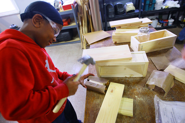 Kokomo Urban Outreach programs that teach kids life skills and helps them earn some money on January 27, 2020. Japrece Walkup-Evans, 10 working on the boxes that will be completed in the paint shop to sell.<br /> Tim Bath   Kokomo Tribune