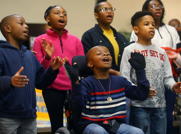 9-year-old Brendan Johnson, center, sings with the Second Missionary Baptist Church Celstial and Next Generation choirs during the Dr. Martin Luther King, Jr. Celebration at Second Missionary Baptist Church on Saturday, Jan. 18, 2020.<br /> Kelly Lafferty Gerber | Kokomo Tribune