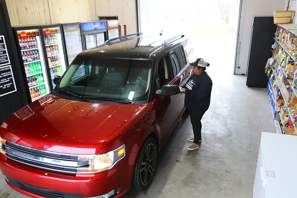 Christin Becker takes an order from a customer at Luci's Carwash and Drive Thru in Converse on January 3, 2020.<br /> Tim Bath | Kokomo Tribune