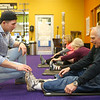 Manager of Tipton's Anytime Fitness Dakota Cole works on stretching with Herb Haubold in the Actively Aging class on Jan. 22, 2020. Cole was on Undercover Boss when brand president of Anytime Fitness came for a visit.<br /> Kelly Lafferty Gerber | Kokomo Tribune