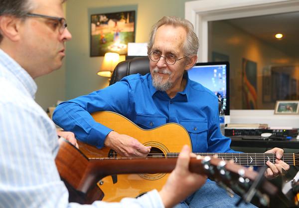 Instructor Gary Rhum plays the guitar with student Tim Gatewood, left, in a guitar lesson at Rhum Academy on January 9, 2020.<br /> Kelly Lafferty Gerber | Kokomo Tribune