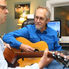 Instructor Gary Rhum plays the guitar with student Tim Gatewood, left, in a guitar lesson at Rhum Academy on January 9, 2020.<br /> Kelly Lafferty Gerber | Kokomo Tribune
