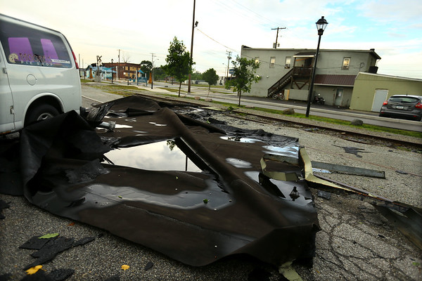 The roof of Tom Thumb sits on the other side of the railroad tracks blown off by the  massive storm surge came together in downtown Kokomo on Wednesday afternoon July 8, 2020. Most of the damage, including about 10 big trees, that the city removed occured within a mile of downtown.<br /> Tim Bath | Kokomo Tribune