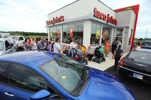 Taco John's on Broadway in Peru opened Monday morning July 20, 2020. Some people camped out all night to be one of the first 100 who received FREE Potato Oles for a year. Cars wrap around and into the street lined up for about a 1/4 of a mile waiting for the drive-thru.<br /> Tim Bath | Kokomo Tribune