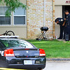 Kokomo Police investigate after a 12 year-old boy was shot at Terrace Meadows Apartments on Tuesday evening July 14, 2020. Witnesses say that he was grilling while a stray bullet from a gun fight in the street hit him.<br /> Tim Bath | Kokomo Tribune