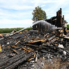 Wildcat Creek Twp Volunteer firefighters put out some hot spots in a house that burned the night before at 3323 East 600 North in Tipton County on July 15, 2020.<br /> Tim Bath   Kokomo Tribune