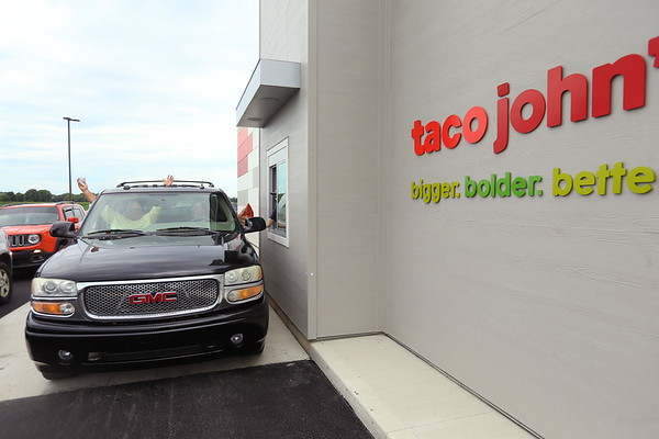 Taco John's on Broadway in Peru opened Monday morning July 20, 2020. Some people camped out all night to be one of the first 100 who received FREE Potato Oles for a year. The first ones through the drive-thru were Terry Briscoe and Dave Birnell.<br /> Tim Bath | Kokomo Tribune