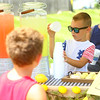 6-year-old Gavin Whitacre operates his lemonade stand near the entrance of Indian Heights on Friday, July 3, 2020. All the money earned from his lemonade stand will be donated to Taylor Godfrey and her family. Taylor was seriously injured in a car accident in May.<br /> Kelly Lafferty Gerber | Kokomo Tribune