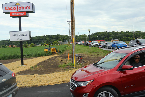 Taco John's on Broadway in Peru opened Monday morning July 20, 2020. Some people camped out all night to be one of the first 100 who received FREE Potato Oles for a year. The drive thru-thru line extended almost to US 24 even after the store had been open for almost an hour.<br /> Tim Bath   Kokomo Tribune