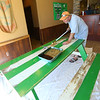 Farm2Fork is finishing up final details on Thursday July 2, 2020, for a Saturday opening in their new location at the corner of Southway and SR 931. Brad Martin puts a clear coat on the tables in the dining room, something the old location did not have.<br /> Tim Bath | Kokomo Tribune