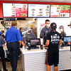 Taco John's on Broadway in Peru opened Monday morning July 20, 2020. Some people camped out all night to be one of the first 100 who received FREE Potato Oles for a year. Some of the earliest arrivals in line Sunday evening received Taco John's shirts.<br /> Tim Bath | Kokomo Tribune