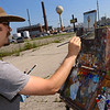 Aaron Pickens, an art teacher at IUK, paints the water tower at the FCA Kokomo Transmission Plant on July 1, 2020. <br /> Tim Bath | Kokomo Tribune