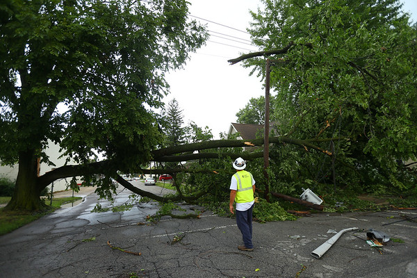 Duke energy gets ready to work on the lines at Elm and Armstrong Streets as a massive storm surge came together in downtown Kokomo on Wednesday afternoon July 8, 2020. Most of the damage, including about 10 big trees, that the city removed occured within a mile of downtown.<br /> Tim Bath | Kokomo Tribune