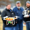 Purdue Extension UAV Signature Program drone training held at the Tipton County fairgrounds ending with flying skills training on March 2, 2020. Austin Guckien and Greg Hensley listen to instructor Adam Shanks talking about the automated flying that the drone is capable of.<br /> Tim Bath | Kokomo Tribune